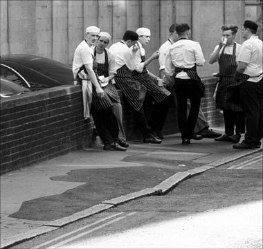 © Rupert Ganzer. Cooks of The Square restaurant having a rest at Bruton Lane in London. Creative Commons: https://creativecommons.org/licenses/by-nc-sa/2.0/